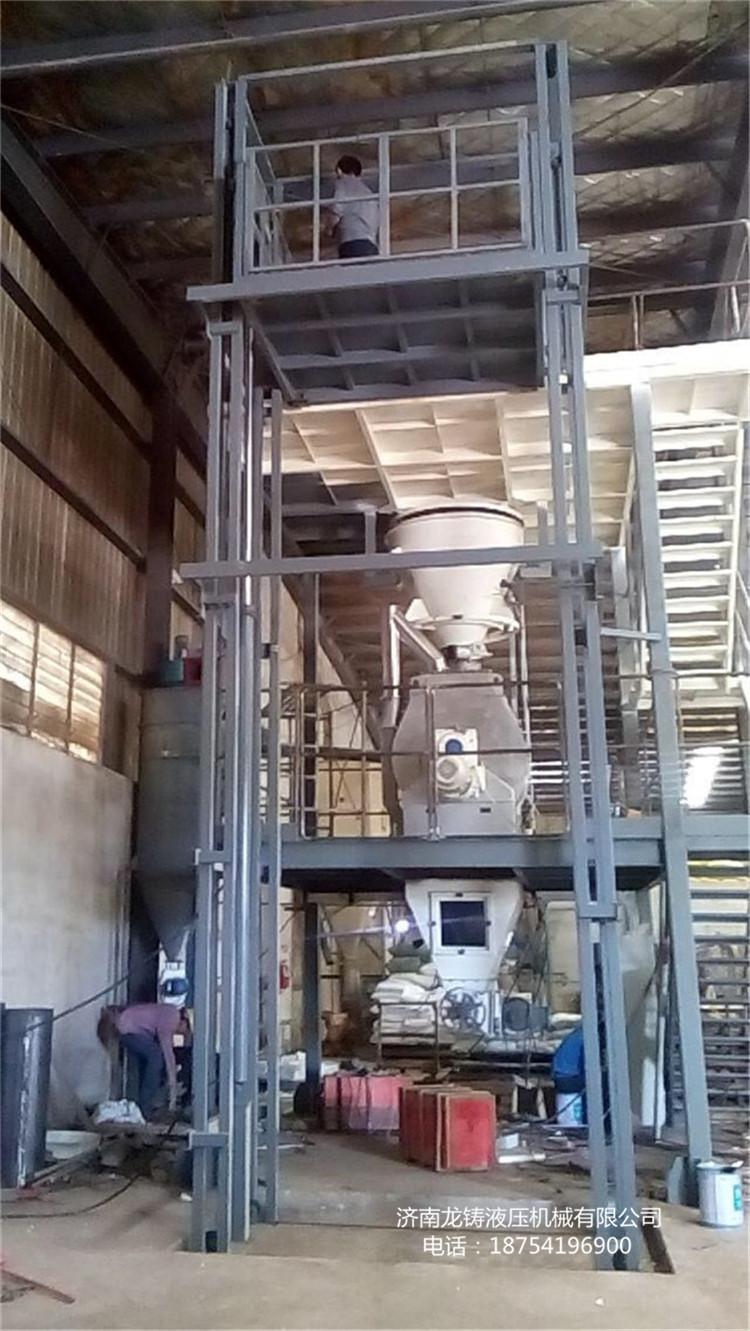 济南电动液压提升机家用小型升降台两层三层四层货物输送机导轨式升降图片