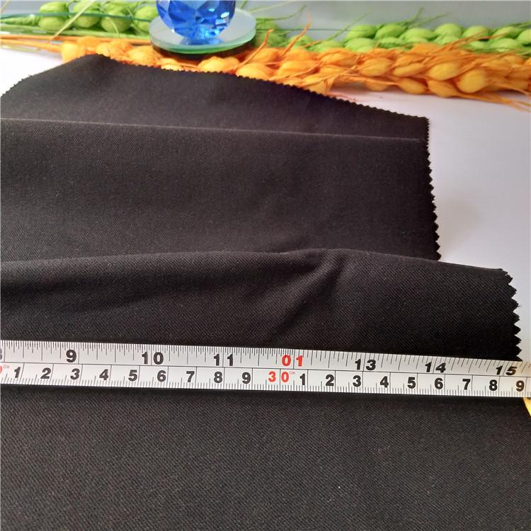 秋冬斜纹黑色羊毛裤料外套棉布料